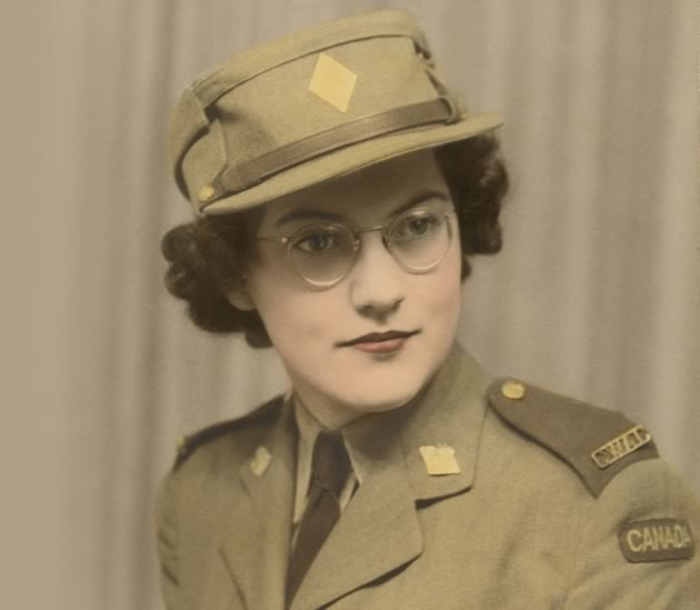"""Doris, whose last name was Evans at the time, had this photo taken and tinted for her 19th birthday as a gift to her mother. She says her choice of army service over air force was """"No contest!"""" – because the army uniform was more flattering to her figure."""
