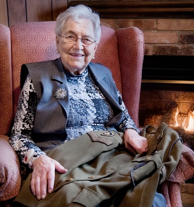 Doris at home in Bolton with her CWAC jacket. Seven decades later, the soft wool serge jacket displaying her corporal chevrons is still in near-perfect condition. Photo by Rosemary Hasner / Black Dog Creative Arts.
