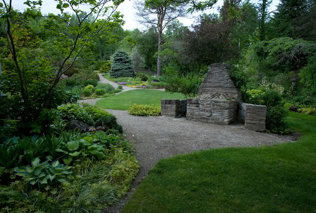 The stone barbecue is being transformed into a crevice garden. Photo by Rosemary Hasner / Black Dog Creative Arts.