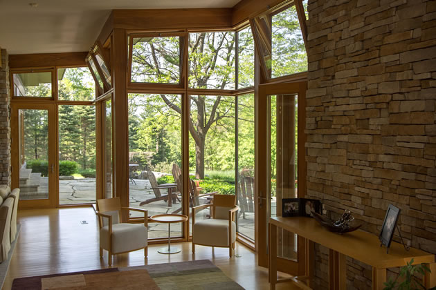 A sitting alcove within the living area takes full advantage of the light and view. Photo by Pam Purves.