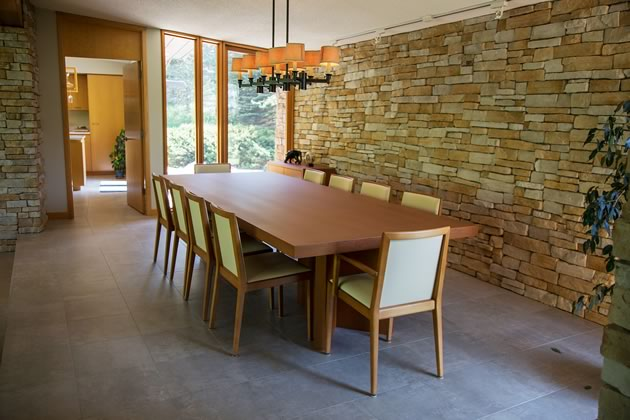 The clean lines of the dining room furniture and the natural colours echo those in the living area. Photo by Pam Purves.
