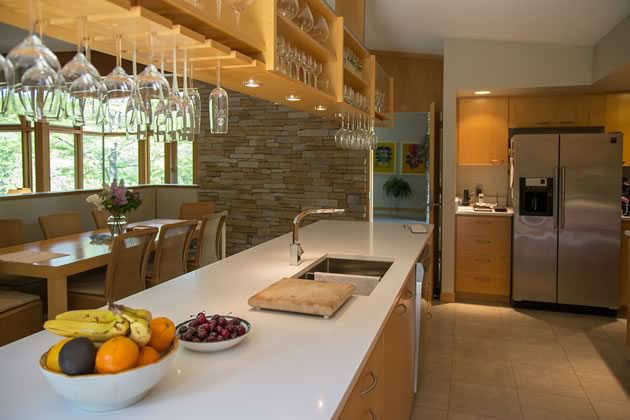 The kitchen is almost invisible from the living and dining areas but overlooks both. Photo by Pam Purves.