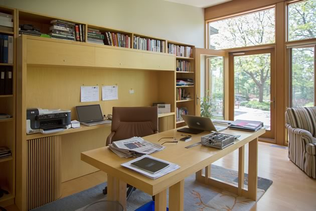 Opposite the library's fireplace is a custom-designed and built workstation with Frank Lloyd Wright influences. Photo by Pam Purves.