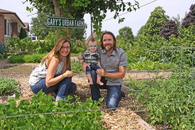 Gary and Crystal Skinn with their son Lennon at Gary's Urban Farm in Orangeville. Photo by Don Scallen.