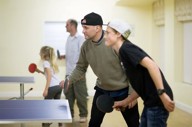 """Newcomers to Mono Centre, Craig Fleetwood and his son Damian make a mean duo at the Ping-Pong table. Along with daughter Felicia, the family finds the weekly night out """"gives us a sense of community,"""" says Craig. Photos by James MacDonald."""