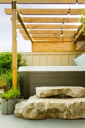The hot tub and its natural rock steps were lifted by crane to the second-storey roof garden. Photo by Erin Fitzgibbon.