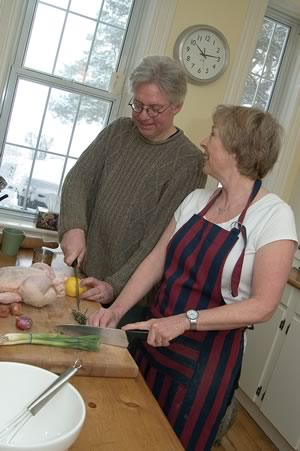Basil Guinane and Cecily Ross cook together in their Mulmur kitchen. Photo by Tom Partlett.