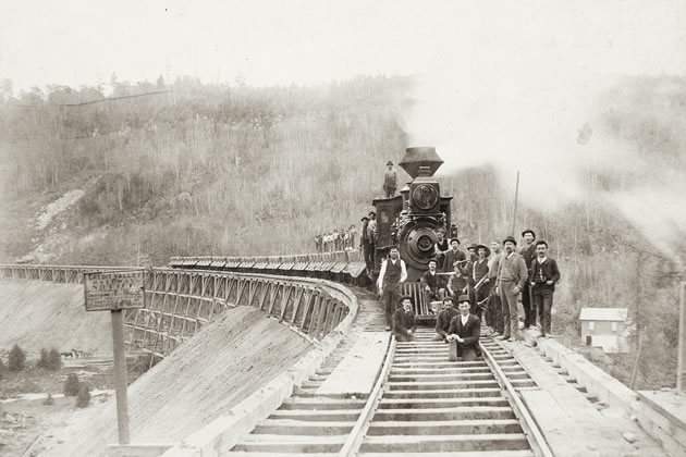 The coming of railway determined the fate of many early communities. Those on the rail route, like Orangeville, thrived; but those that were bypassed often went into decline. Pictured is a train on the trestle bridge at Forks of the Credit, c.1886. Region of Peel Archives / PAMA PN2009.