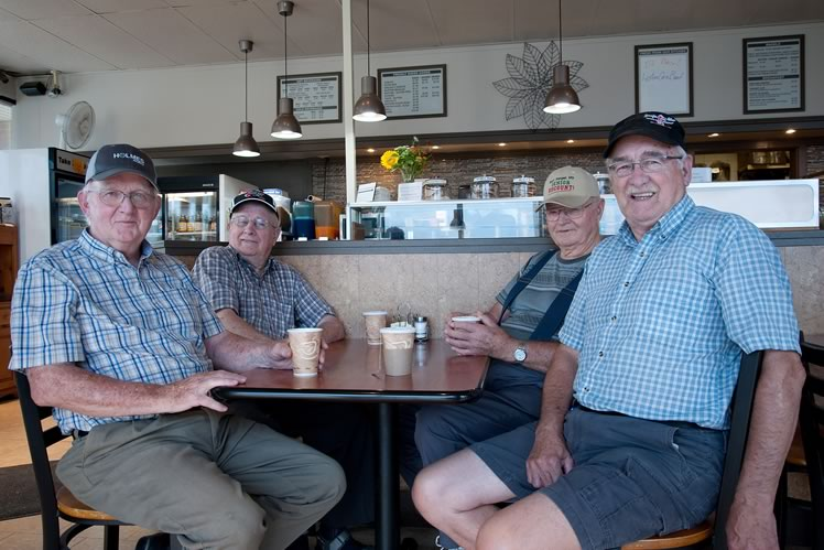 "From left : Bob Currie, Wallace Elgie and Bill Bentley, with Al Widbur, also a Pete's regular. ""The thing is, there's nothing you can do about [ Shelburne's growth ]. You can't stop it. All you can do is try to plan for it and manage it."" Photo by Rosemary Hasner / Black Dog Creative Arts."