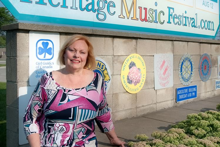 "Lynda Buffett, real estate agent and co-chair of the heritage music festival. ""It used to be that the downtown was struggling, but right now it's doing quite well. That's a big plus from having more people moving into town."" Photo by Rosemary Hasner / Black Dog Creative Arts."