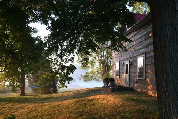 A misty morning at one of the most peaceful home-share rentals in the region. The oldest part of the home is the original 1840s log farmhouse. Courtesy Malcolm Roberts.
