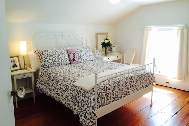 One of the sunlight-filled bedrooms at Malcolm Roberts' farmhouse rental. Courtesy Malcolm Roberts.
