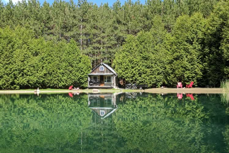 This rustic Mono log cabin is perched at the edge of a spring-fed clay pond. Courtesy Bill Dandie.
