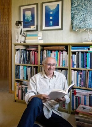 "Dufferin poet laureate Harry Posner at home with his books and his cat Tweed: ""It's not my job merely to reflect local culture, but to stir it up a bit."" Photo by Pete Paterson."