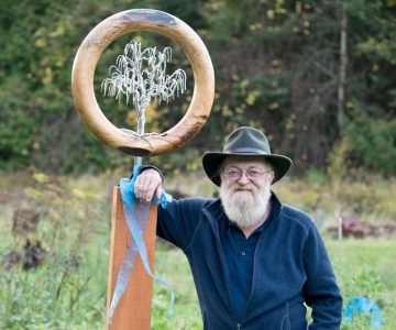 Jay Mowat with a sculpture by woodworker Jennifer McKinnon which his wife Clare gave him this year on his 65th birthday. Photo by Pete Paterson.