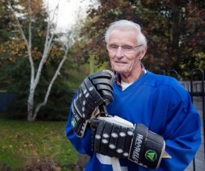 In his mid-80s, Bill Carnegie still plays old-timer hockey once a week and continues to lace up for practice three times a week. Photo by Rosemary Hasner / Black Dog Creative Arts.