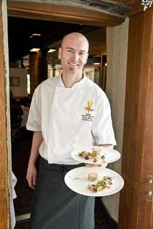 James Buder carries two plates of foie gras torchon into the Headwaters Restaurant at Millcroft Inn & Spa. Photo by Pete Paterson.