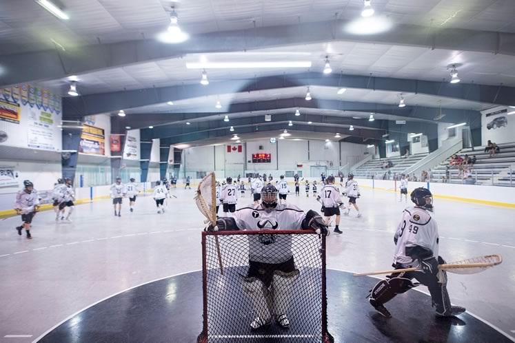 Jr. A Northmen goalies – Cam Dunkerley (left) and Ryan Hartley – during the warmup at a Tony Rose Memorial Sports Centre game against the Barrie Lakeshores. In the background are minor players who assist as ball boys and girls or play in intermission scrimmages. Photo by James MacDonald.