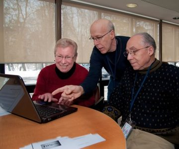 Ken Wynne (centre) teaches tech know-how to Mary Mansdy and Lloyd Andrade in Caledon's Seniors Helping Seniors program. Photo by Rosemary Hasner / Black Dog Creative Arts.