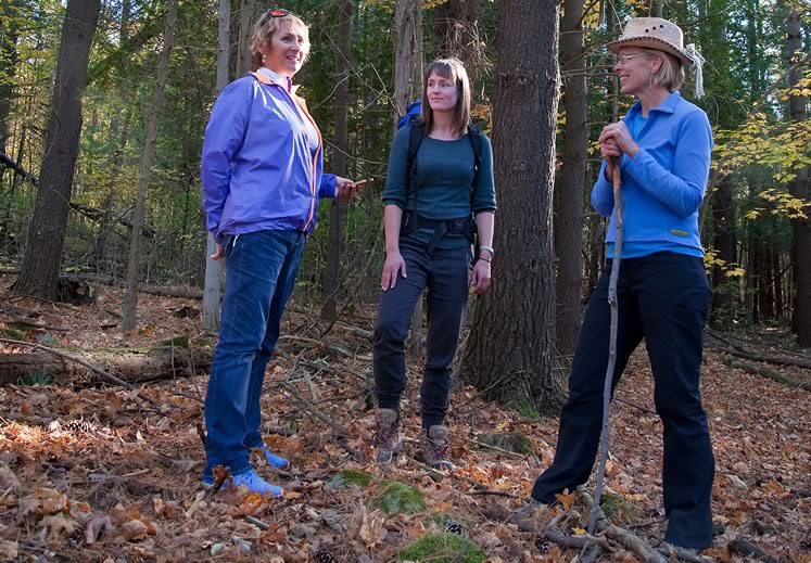 Nature therapy guide Kaitlyn Powers (centre) instructs writing pals Gail Grant (left) and Nicola Ross how to be still, breathe deeply and absorb nature with all their senses – followed by tea. Photo by Rosemary Hasner / Black Dog Creative Arts.