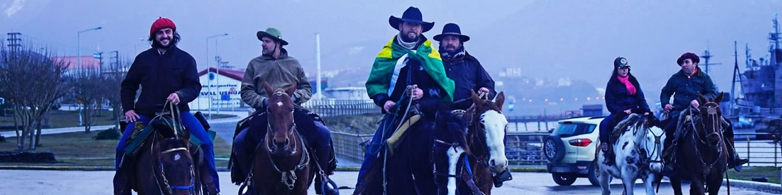 At journey's end in Ushuaia, a smaller crowd of devotees welcomed Filipe and Pablo Picasso, including a group of local gauchos and his sister Izabella. Photo by Barbara Nettleton.