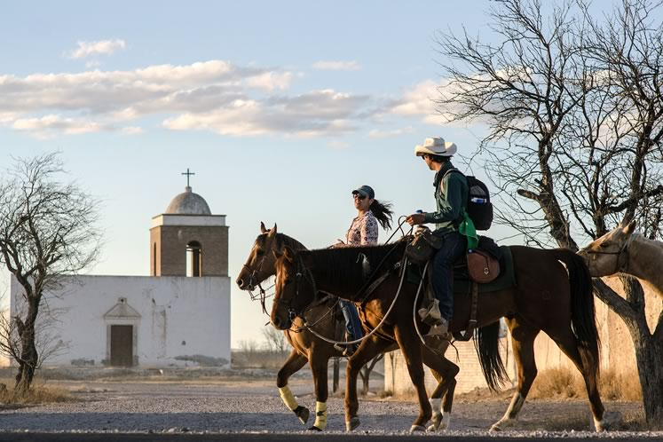 A local horsewoman accompanied Filipe as he rode into Mexico through Jiménez. Photo by Barbara Nettleton.