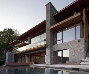 The home's lower level features walkouts to an infinity pool. Photography © Ben Rahn / A-Frame.