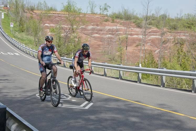 Don Coats (left) tested his mettle, with the help of an e-bike, against younger and fitter triathlete Sean Bechtel on his road bike. Photo by Pete Paterson.