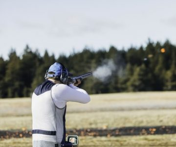 A trap shooter tests his skills with a 12-gauge pump-action shotgun. Photo by Visualspace | istockphoto.