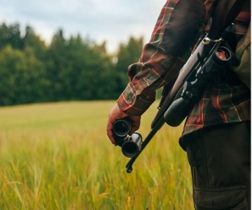 A hunter takes to the field with a bolt-action rifle, commonly used for hunting deer and moose. Photo by Visualspace | istockphoto.