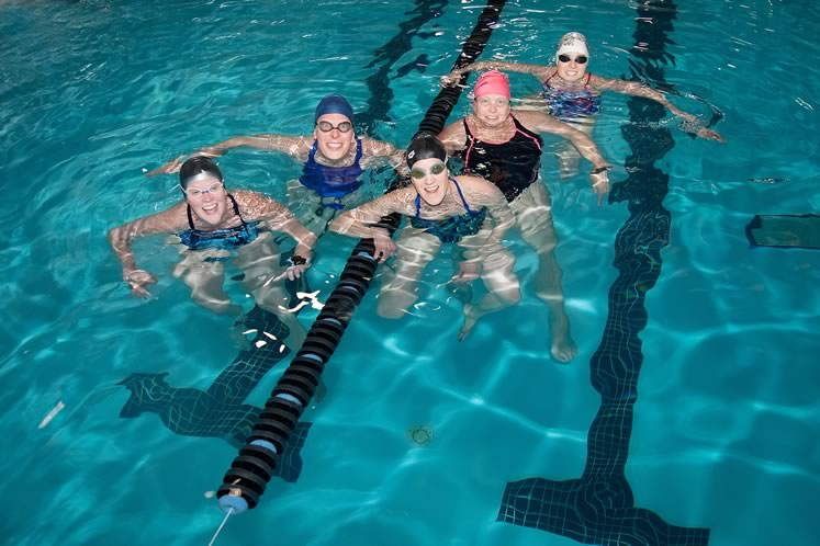 Left to right : Enthusiastic master swimmers Sherri Curry, Melody Wiseheart, Stephanie Sostar, Kimberly McGowan and Jo Coburn. Photo by Rosemary Hasner / Black Dog Creative Arts.