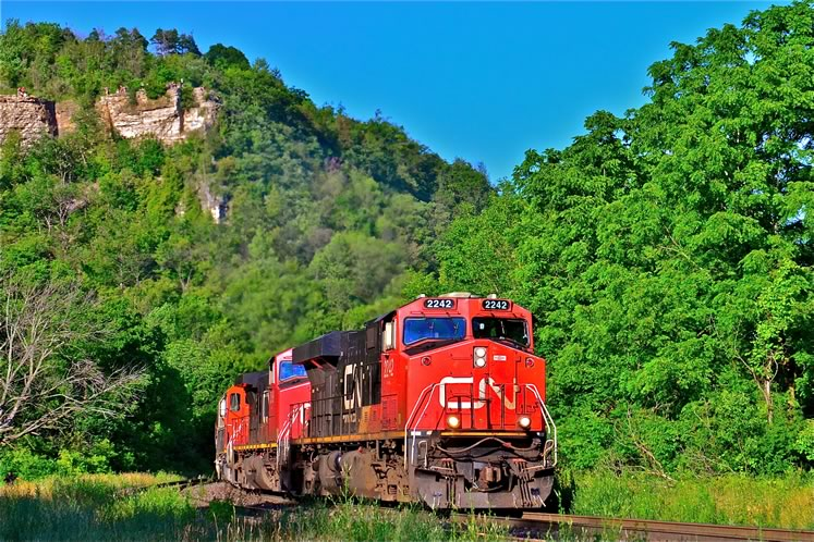 Dundas, ON – listening to the 12,000 combined horsepower of the locomotives being dragged down to 3 mph as they climb the Niagara Escarpment; the same scene repeated daily as the trains travel westbound through Campbellville. Photo by Brandon Muir.