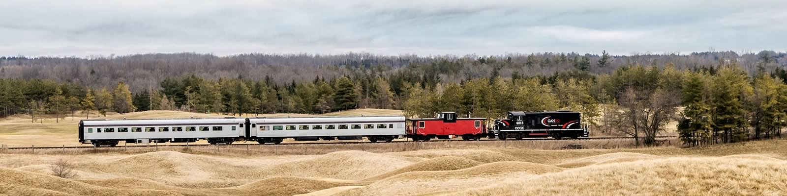 The Credit Valley Explorer glides through the rolling hills at Caledon's Osprey Valley Golf Club during its final excursion on the OrangevilleBrampton Railway on February 30. New operator Gio Railways has no immediate plans to bring back the tourist service. Photo by Warren Schlote.