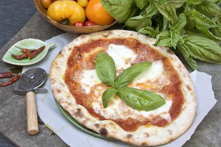 Four Corners' classic Margherita pizza features a fresh tomato sauce, buffalo mozzarella and fresh basil on a thin homemade crust. Photo by Pete Paterson.