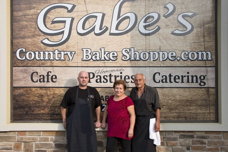 The Giraldi family: With Gabe (left) as front man, and his parents Anna and Tony whipping up wonders in the kitchen, the bakery and coffee shop is a longtime fixture of the Caledon East scene. Photo by Pete Paterson.