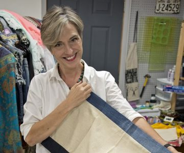 Textile artist Heather Chapplain shows off the fabrics she collects for the one-of-a-kind pieces she makes in her Alton studio. Photo by Rosemary Hasner / Black Dog Creative Arts.
