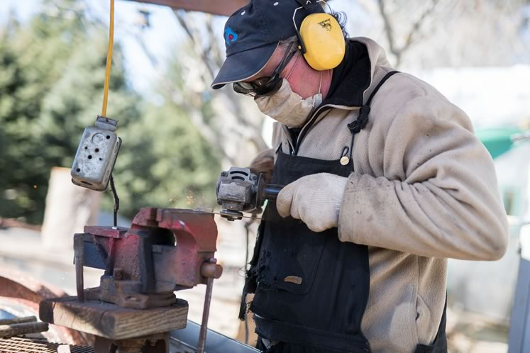 Dan works with vintage metal pieces – many from rusty farm implements he collects. Photo by James MacDonald.