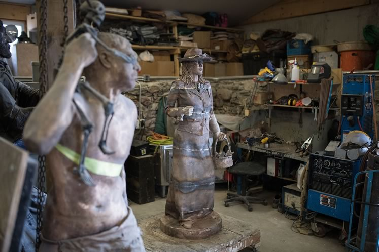 Two bronze works-in-progress, John created the 1830s woman who now stands at the Rosemont Hall on Highway 89. Photo by James MacDonald.
