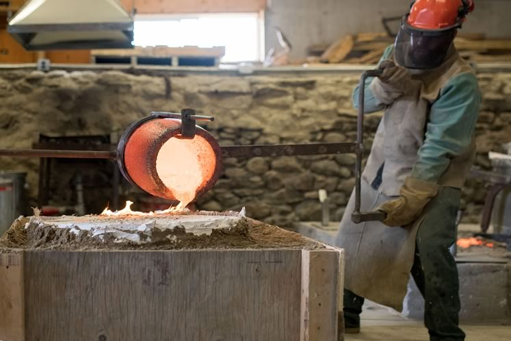 Molten bronze is prepared for a pour at John M.J. Farrugia's Craganrock Studio in Mono. Photo by James MacDonald.