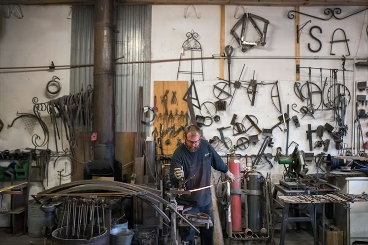 The myriad forged pieces and collected items at Tyler's workshop make for an artful display. Photo by James MacDonald.