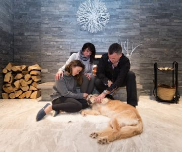Miyeko and Mike Simons gather by the fireplace for family time in their newly renovated Orton home with daughter Abby and late family pet, Daisy. Mike did most of the work himself, with the help of Orangeville's CarPony Contracting. Photo by Erin Fitzgibbon.