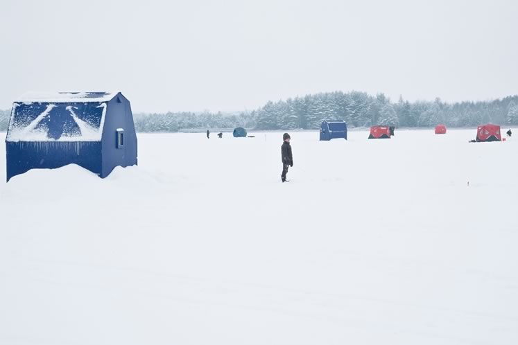 A variety of huts dot the ice on Orangeville's Island Lake during the 2018 ice fishing derby. Photo by Rosemary Hasner / Black Dog Creative Arts.