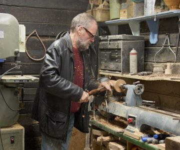 Barry Young works on a pepper mill at a lathe in his Alton workshop. Photo by Pete Paterson.