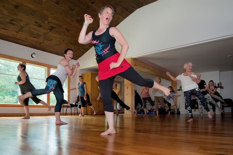 "Mary Baxter (centre) and her co-instructor Sarah Butler (centre left) lead a Nia session at the Ecology Retreat Centre: ""Fall in love with feeling good and the joy of movement."" Photo by Rosemary Hasner / Black Dog Creative Arts."
