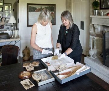 Robin works with archivist Alison Hird to document the Howard family heirlooms and papers in the dining room of her Caledon home. Photo by Pete Paterson.