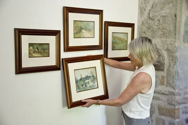 Among Robin's most cherished inherited items is a series of watercolour paintings by her great-grandfather A.H. Howard. She changes up their locations often throughout her home. Photo by Pete Paterson.