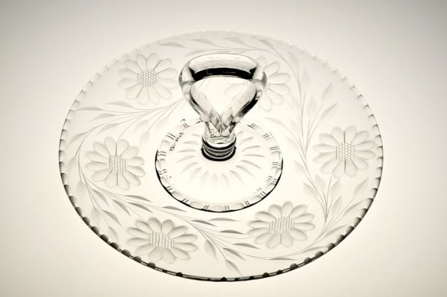 The clear glass sandwich tray from 1915 shows the iconic Corn Flower motif. Photo by Pete Paterson.