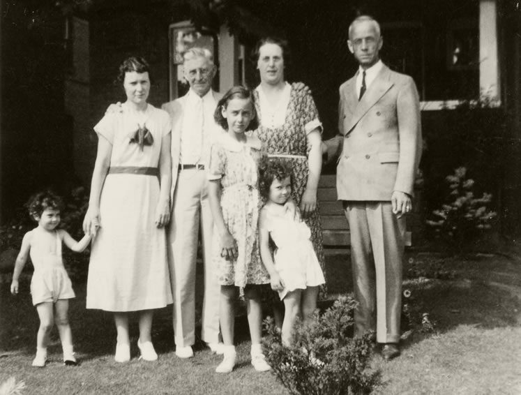 "William John ""Jack"" Hughes (right) with his wife Hazel at his side and their daughter Lois (centre) with relatives at their Toronto home in 1937. Museum of Dufferin P-7044."