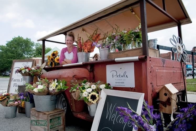 Florist and flower farmer Amber Swidersky sells her blooms at the Shelburne Farmers' Market. Photo by Rosemary Hasner / Black Dog Creative Arts.