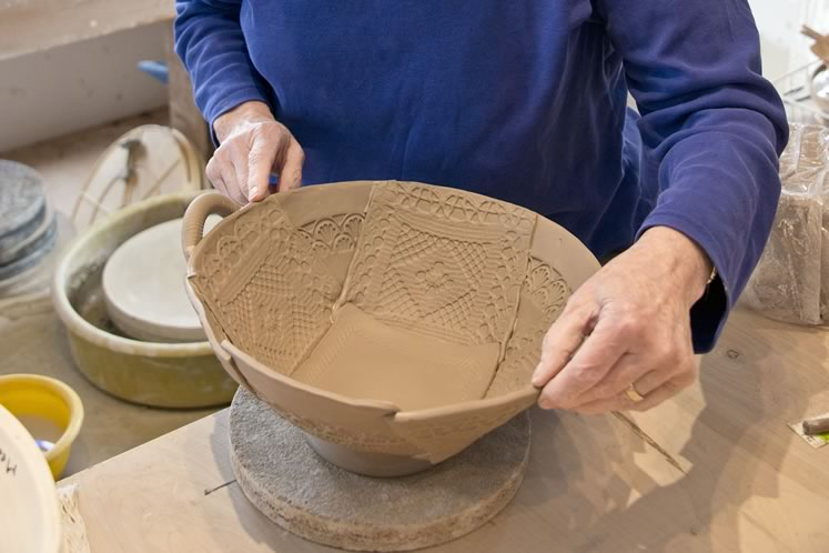 Mary Lazier creates one of her slab pottery bowls at her Mulmur studio. The bowl will be glazed in bluish white. Photo by Pete Paterson.